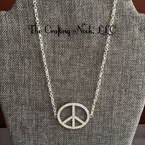 Handmade necklace featuring a Peace pendant